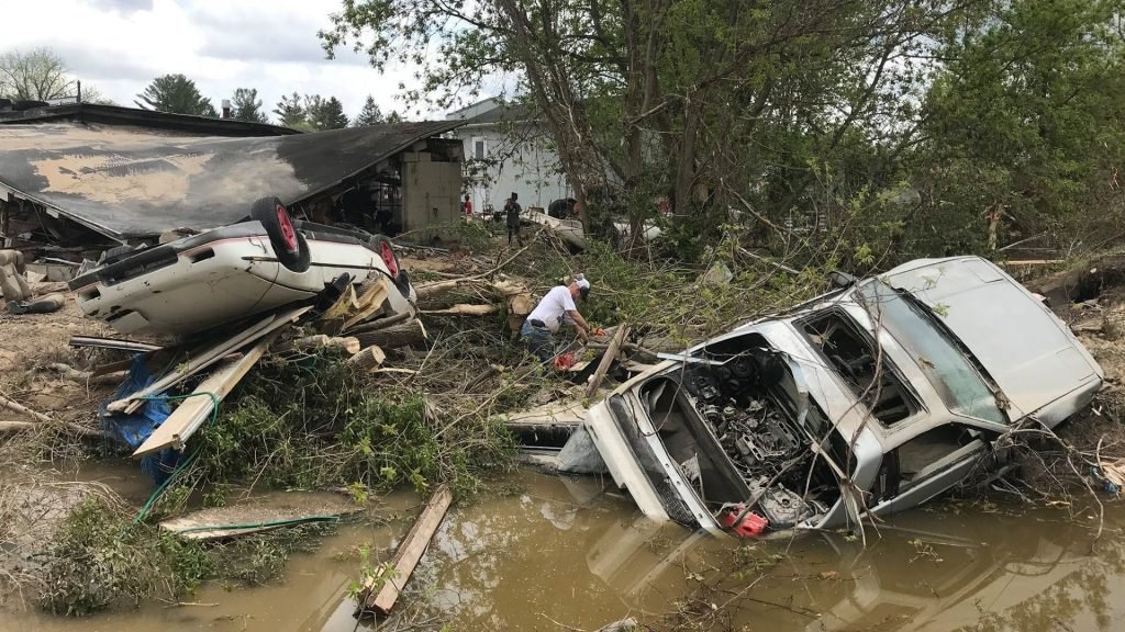 overturned Pontiac Fieros totaled in Michigan flood