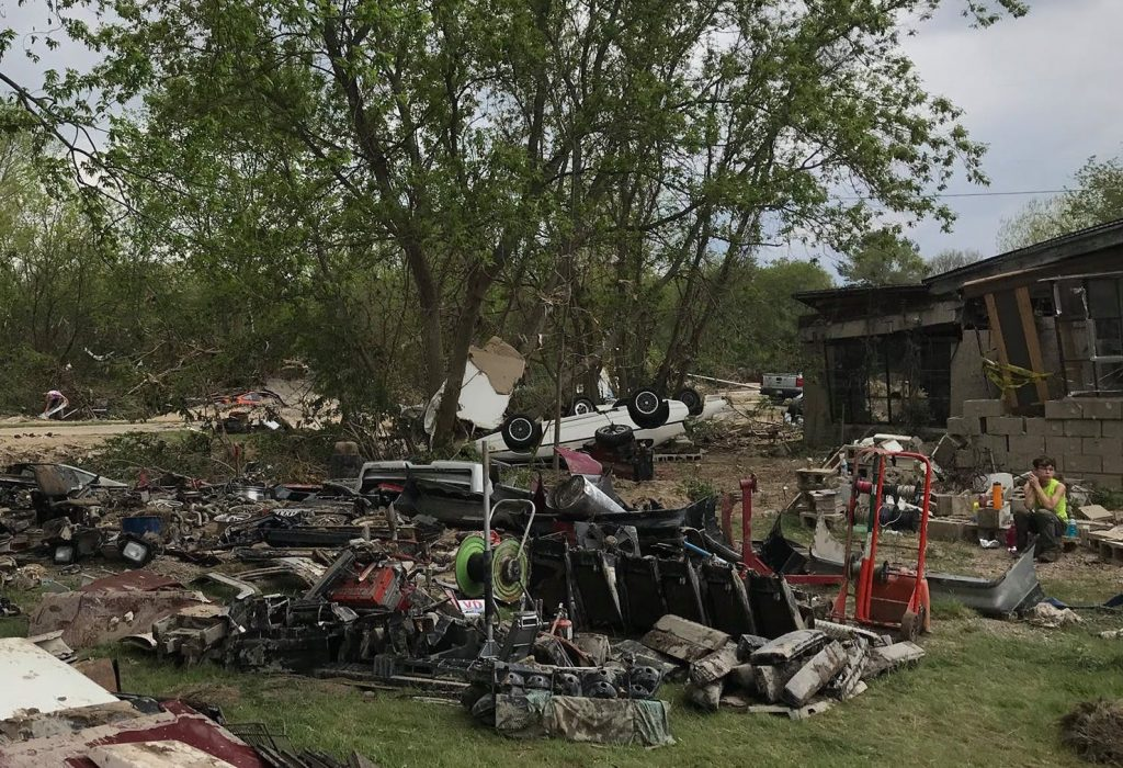 Pontiac Fiero parts strewn about from flood