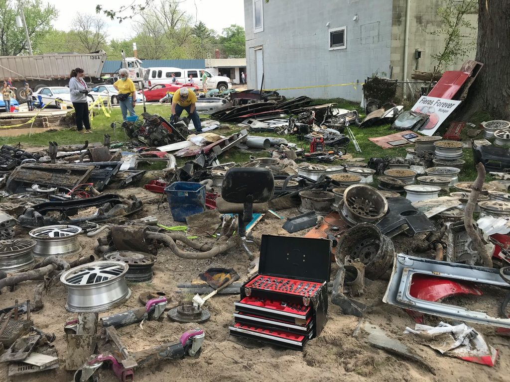 Pontiac Fiero parts strewn around from Michigan flood