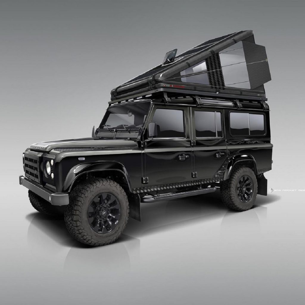 Black carbon-fiber RTC 110 roof tent mounted on black classic Land Rover Defender 110