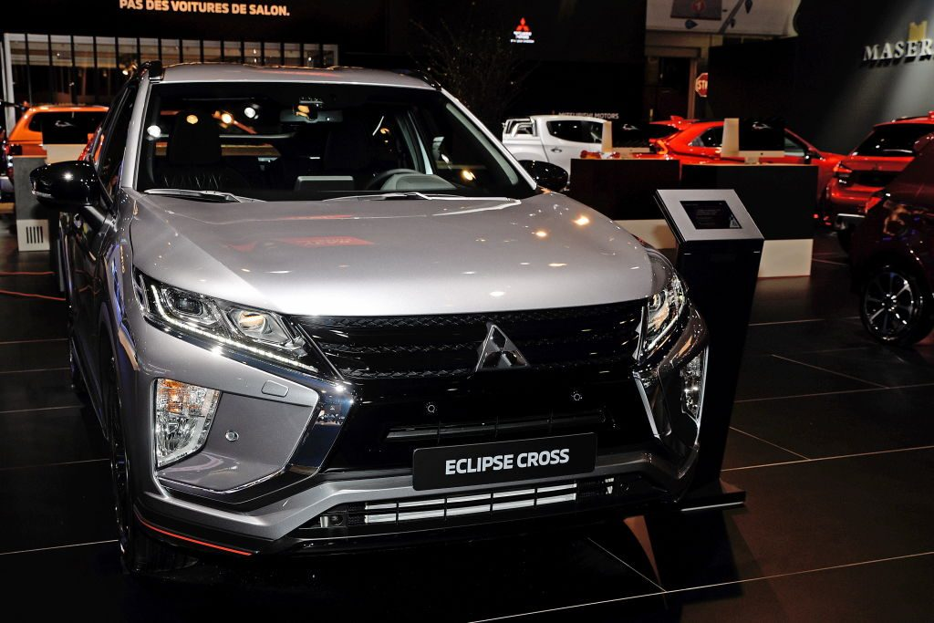 A new Mitsubishi Eclipse Cross on display at an auto show