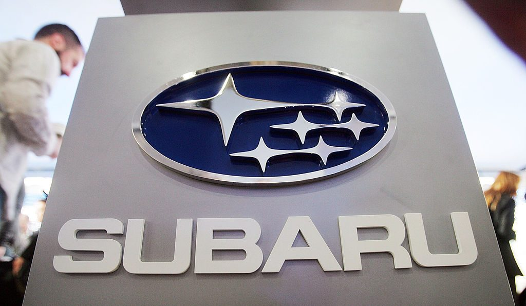 A sign displaying the Subaru logo on display