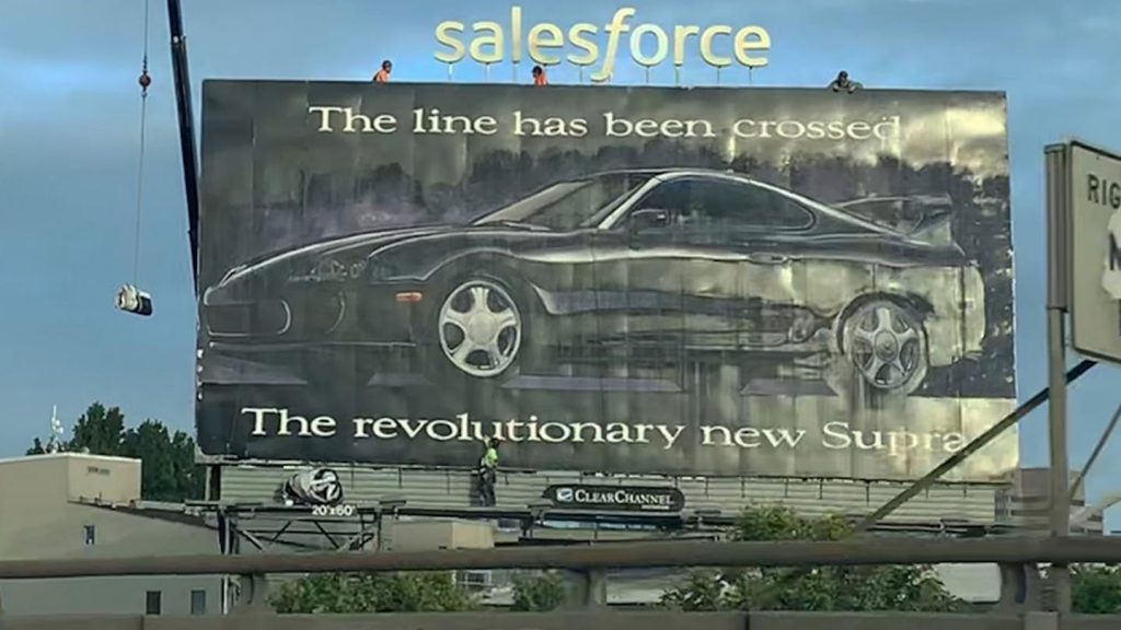 An old 1993 Toyota Supra advertisement on a billboard