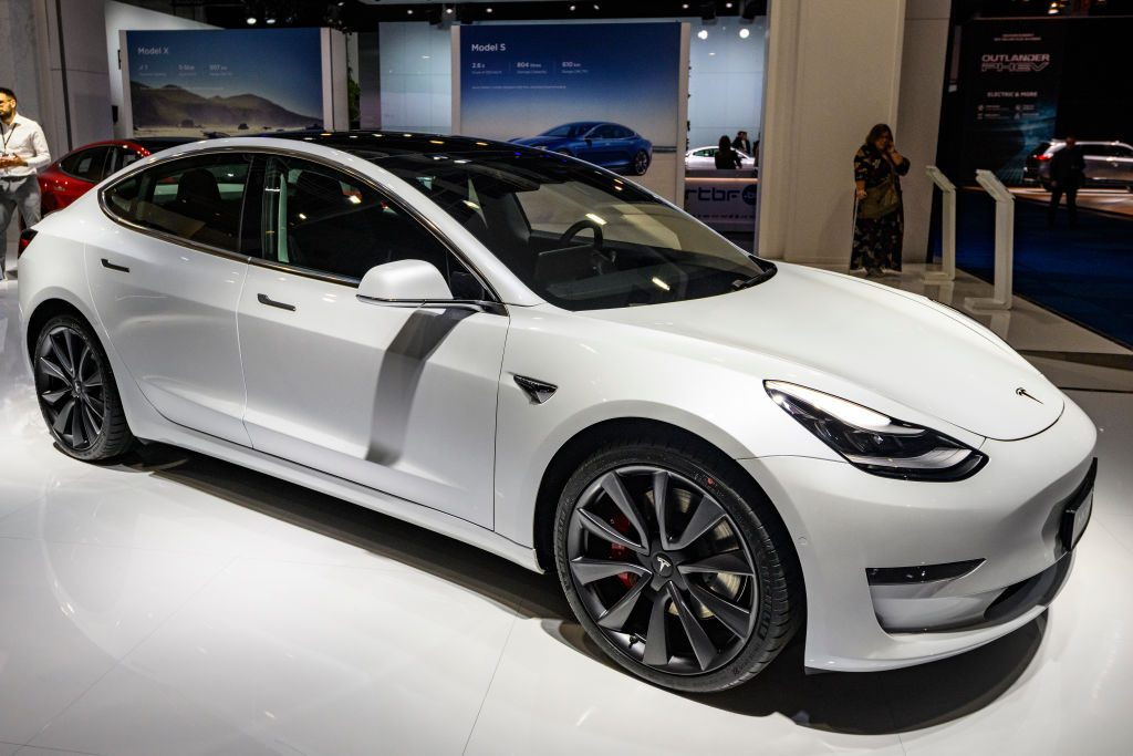 Tesla Model 3 compact sedan car in white on display at Brussels Expo