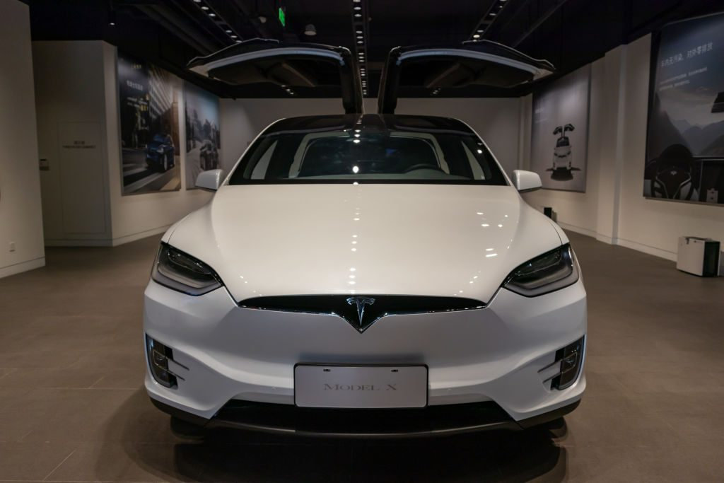 A white Tesla Model 3 on display