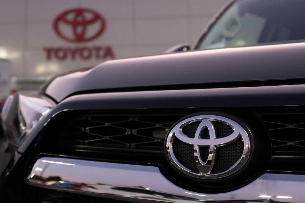 Toyota logo is seen on a Toyota 4Runner at its dealership in San Jose, California on August 27, 2019