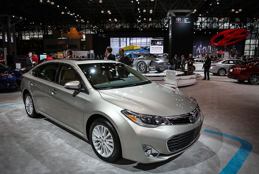 The Toyota Avalon Hybrid on display at an auto show