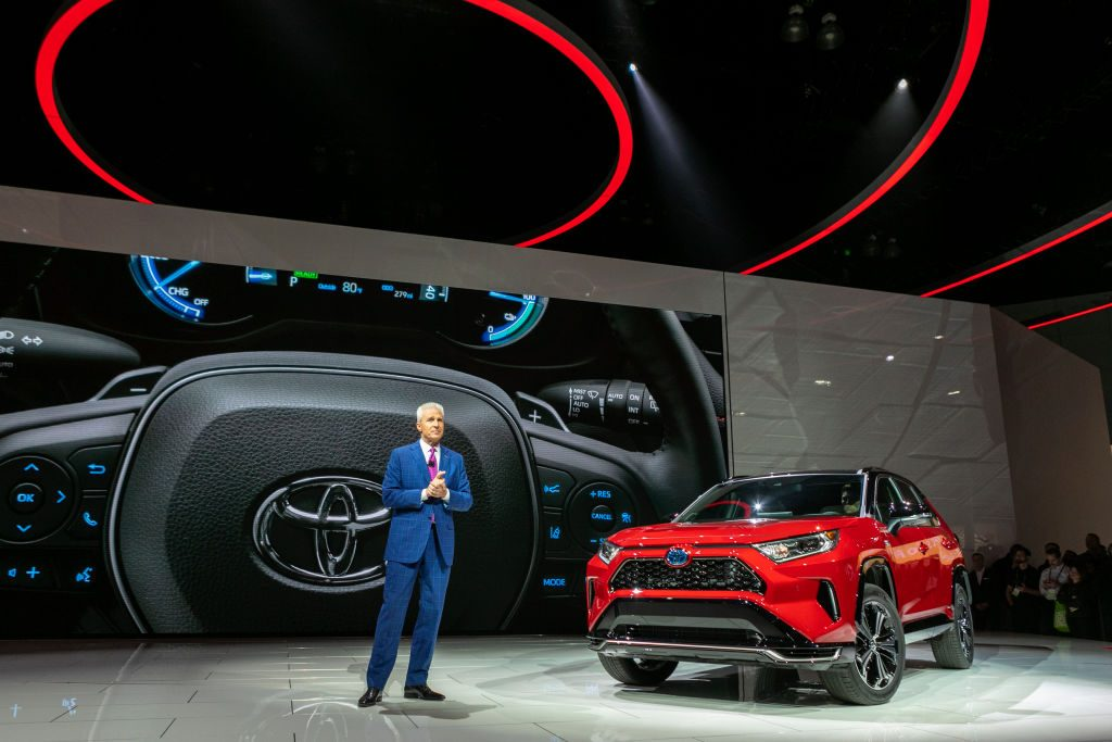 Toyota Motor North America Vice President and General Manager shows the Toyota RAV4 Hybrid at AutoMobility LA