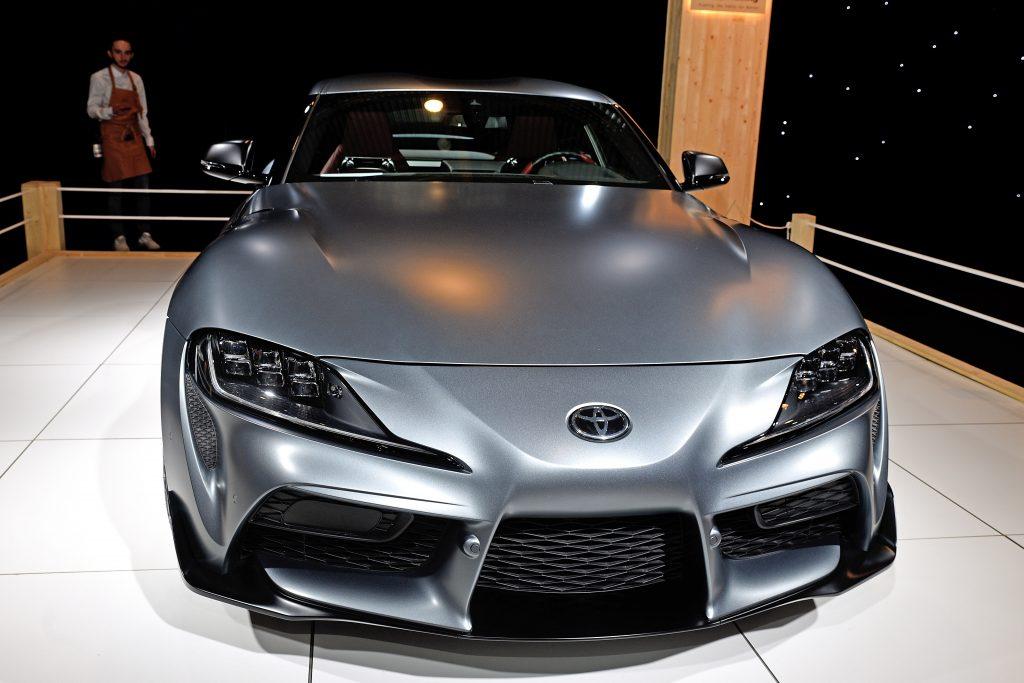 A titanium colored Supra sits on display at a car show