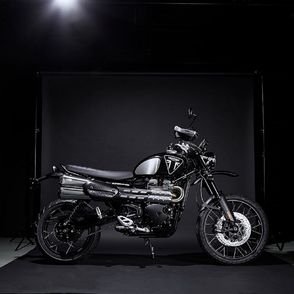 Black Triumph Scrambler 1200 Bond Edition, with 007 badge, blacked-out components, and brushed-foil knee pad