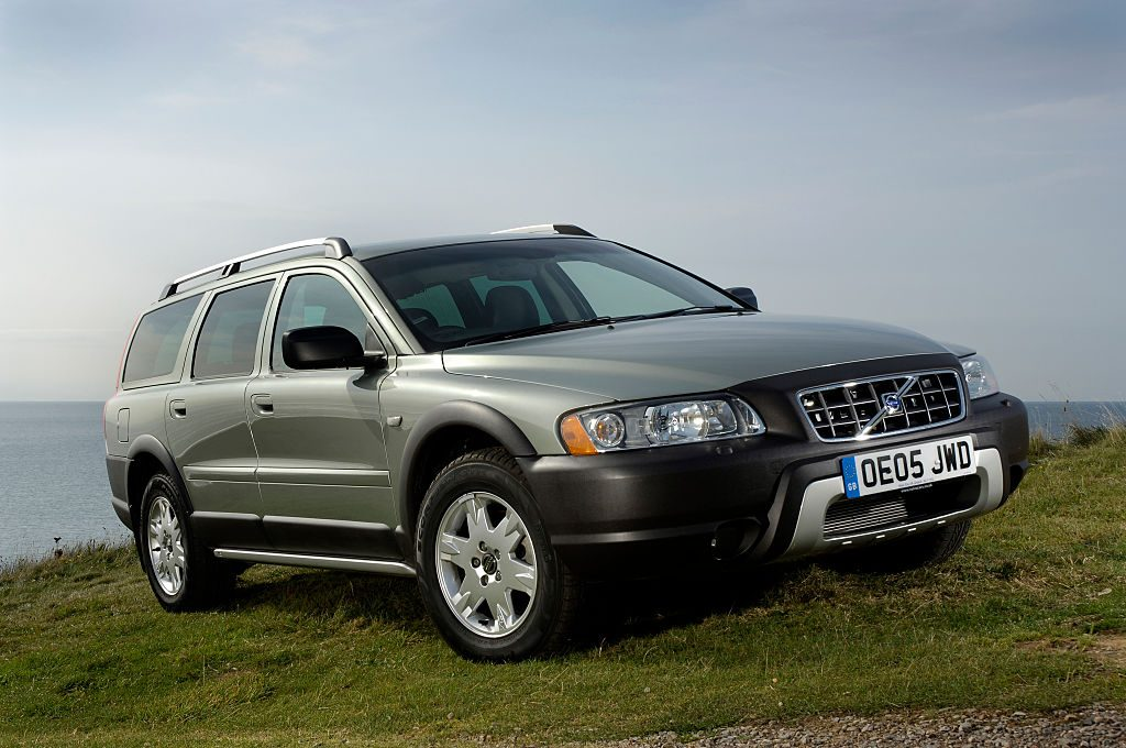 A Volvo XC70 crossover wagon parked on grass for display