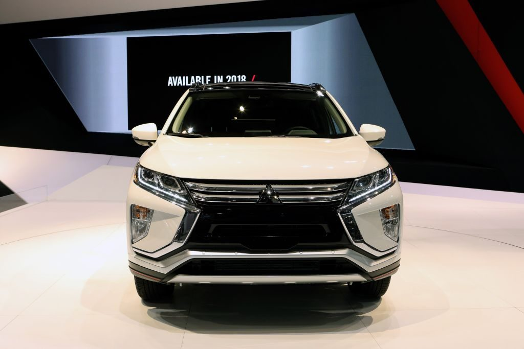 A white Mitsubishi Eclipse Cross on display at an auto show