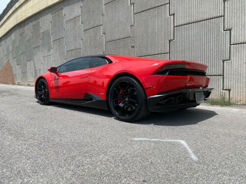 World's highest mileage Lamborghini Huracan in red sitting by the freeway