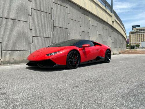 World's highest mileage Lamborghini Huracan in red beside freeway