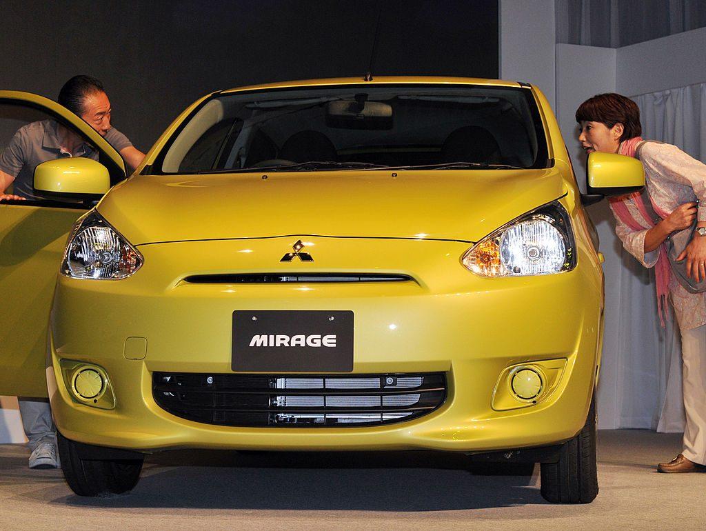 A yellow Mitsubishi Mirage on display