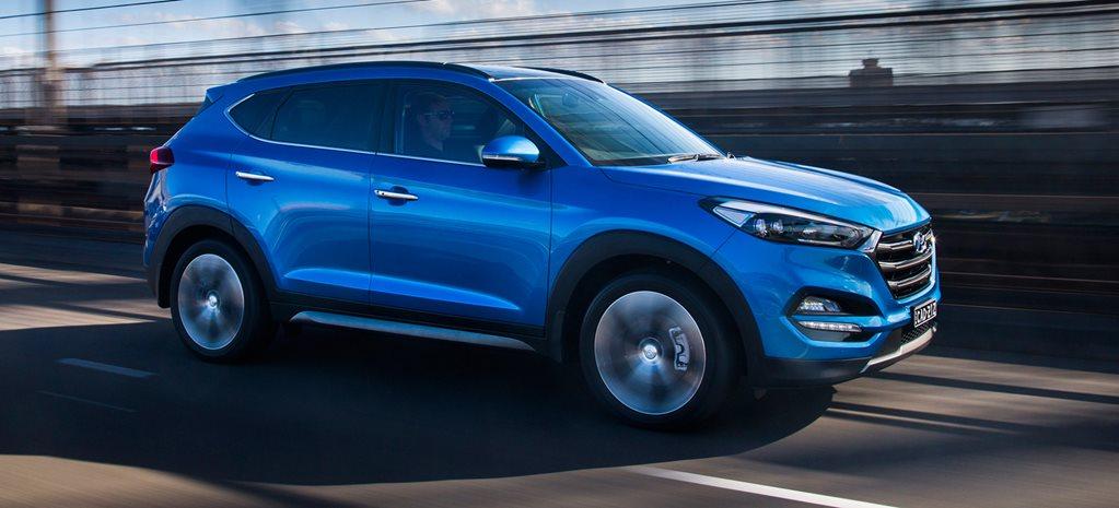 Electric blue 2016 Hyundai Tuscon on the road