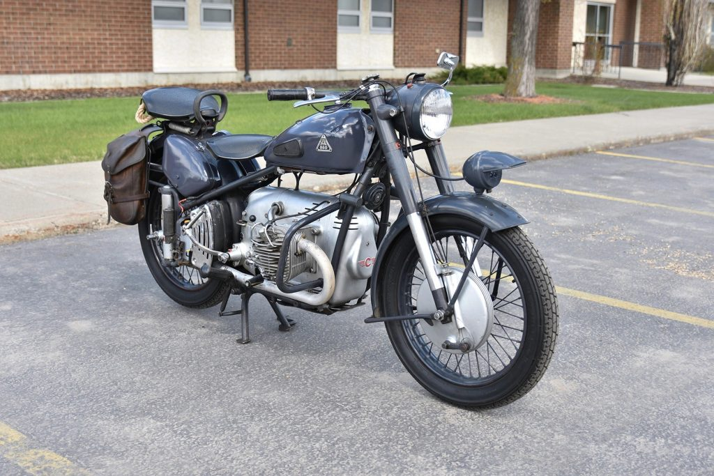 Blue-gray 1953 Condor A580 motorcycle in a parking lot