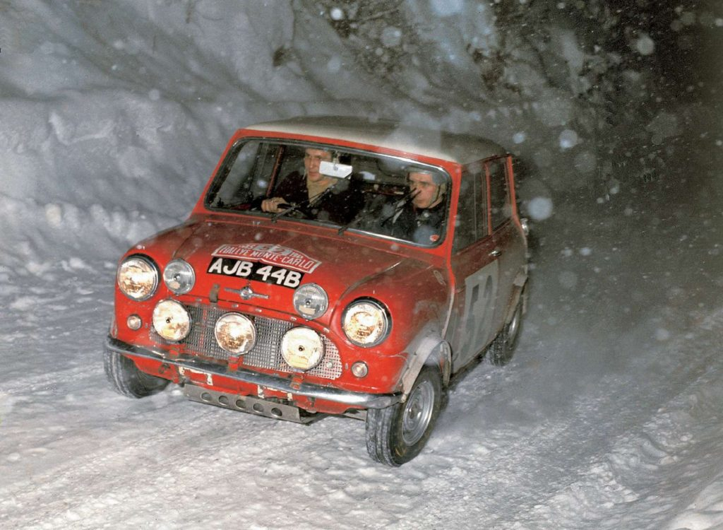 Red 1965 Mini Cooper S racing in the snow at Monte Carlo