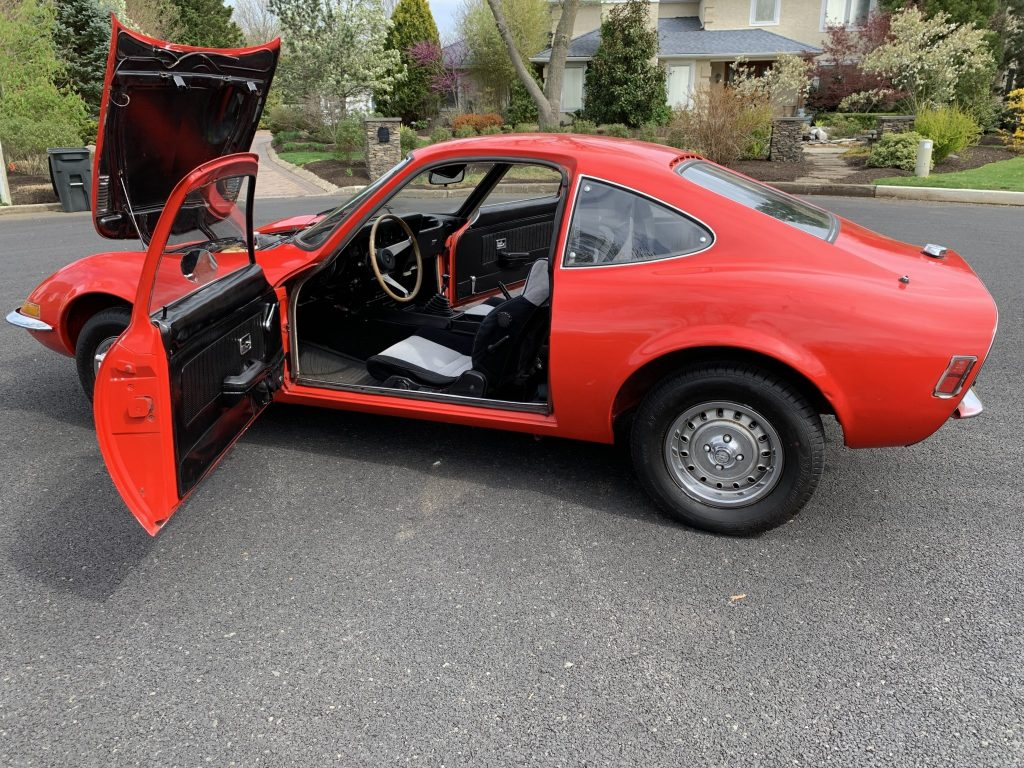 Red 1971 Opel GT with doors and engine hood open