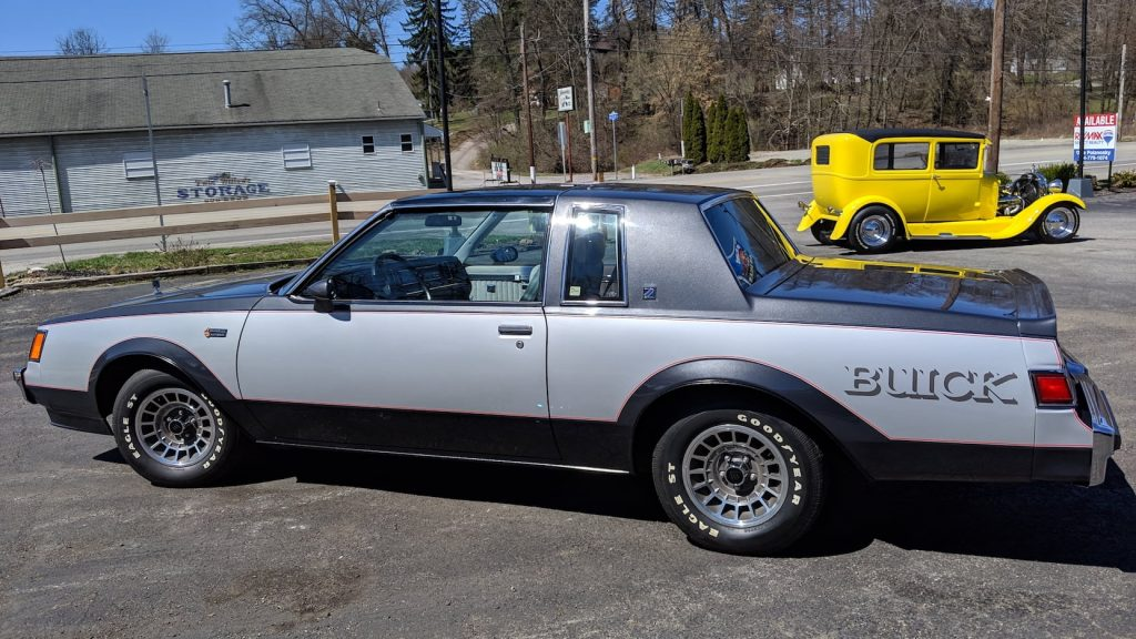 A silver and charcoal two-tone 1982 Buick Grand National in a parking lot.