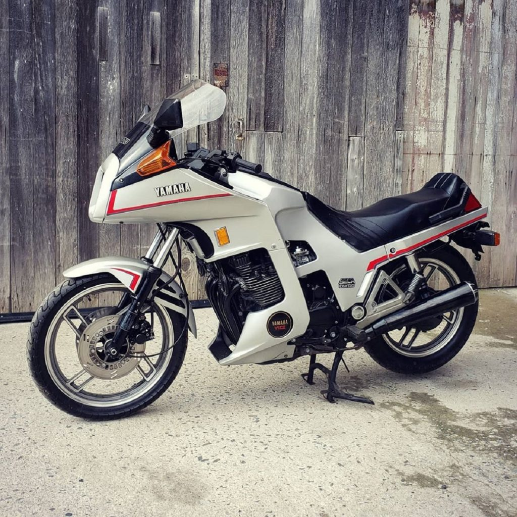 White 1983 Yamaha XJ650 Seca Turbo in front of a fence