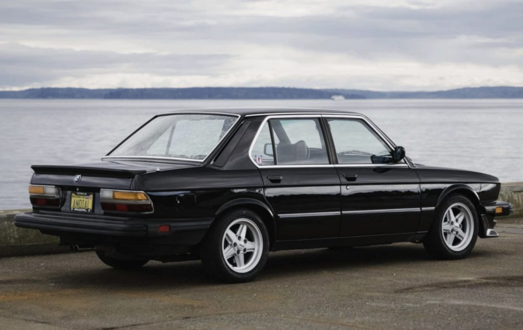 Black 1984 E28 BMW 533i sedan rear view