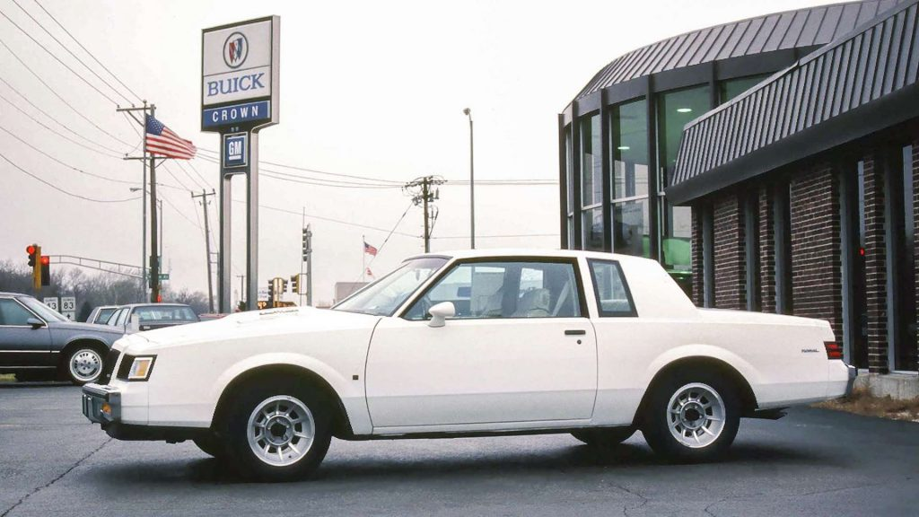 A white 1987 Buick Regal T-Type parked at a Buick dealer