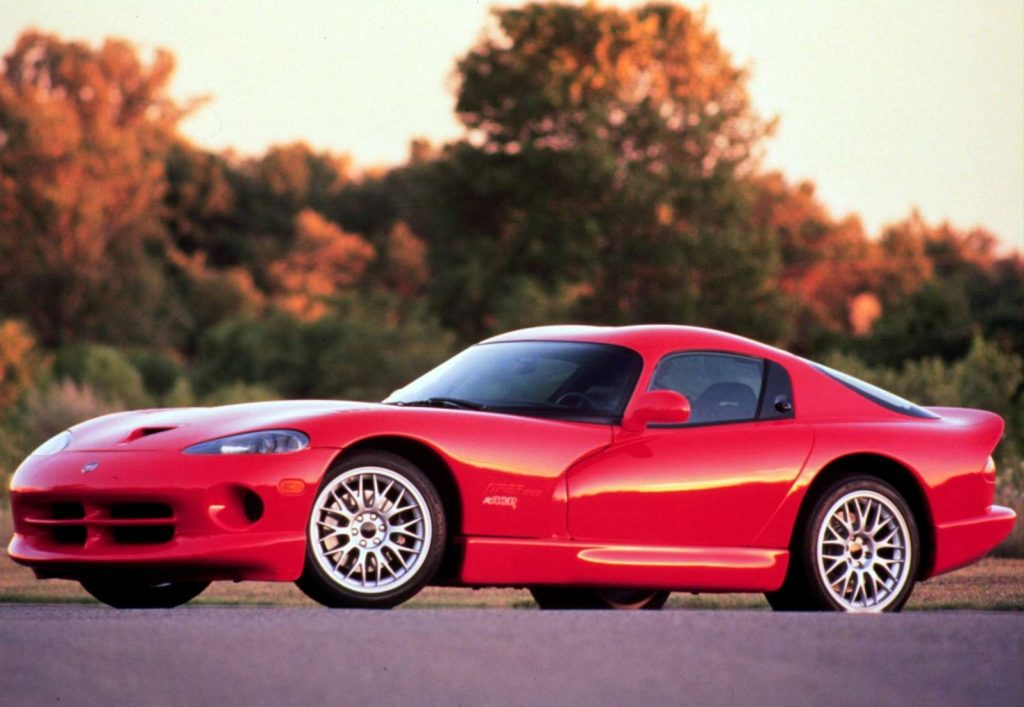 Red 1999 Dodge Viper ACR in front of trees