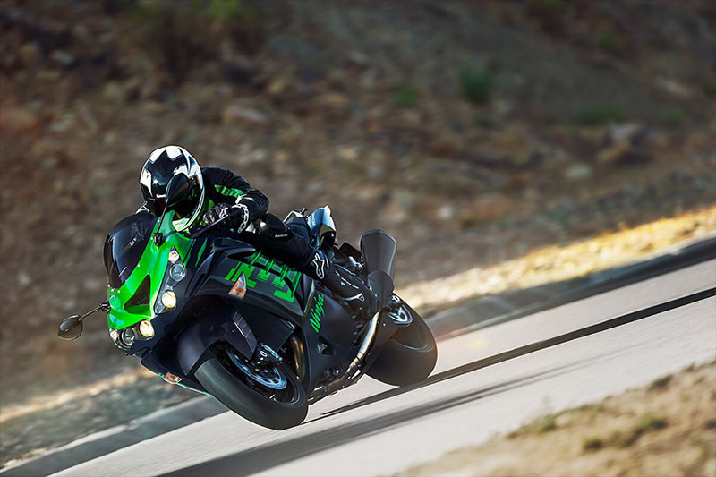 a green Kawasaki zx-14r at speed on the road