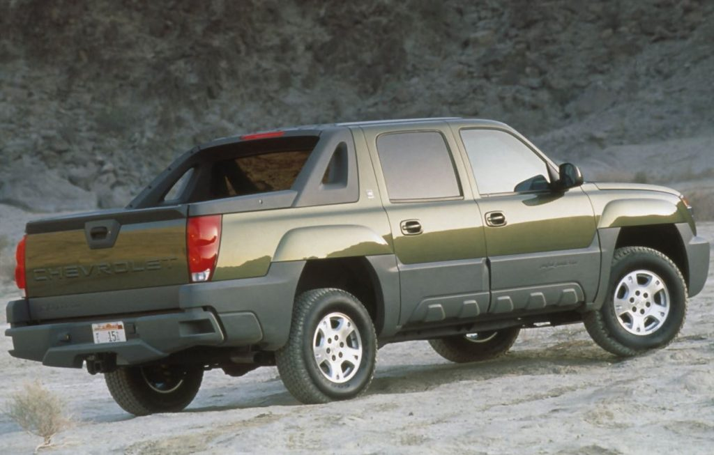 A green Chevy Avalanche is viewed from behind