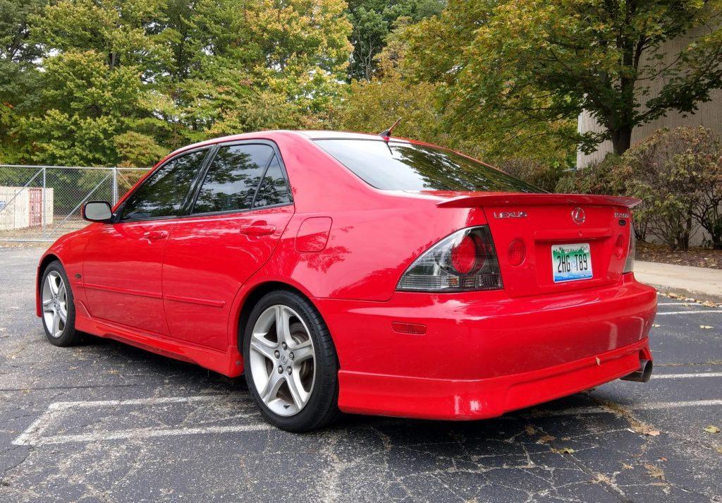 Red 2002 Lexus IS300 L-Tuned Stage II sedan rear view