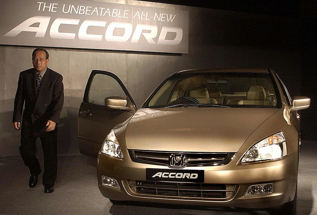 President and Chief Executive Officer (CEO) of Honda Siel Cars India Ltd. H Yamada walk pass the all new Honda Accord car during its launch in New Delhi, 10 June 2003
