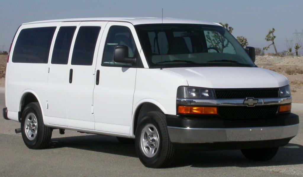 a white 2005 Chevrolet Express full-size passenger van