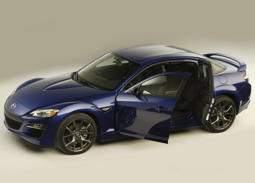 Blue 2009 Mazda RX-8 with its doors open