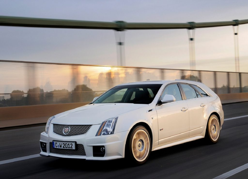White 2011 Cadillac CTS-V Wagon driving on a city bridge