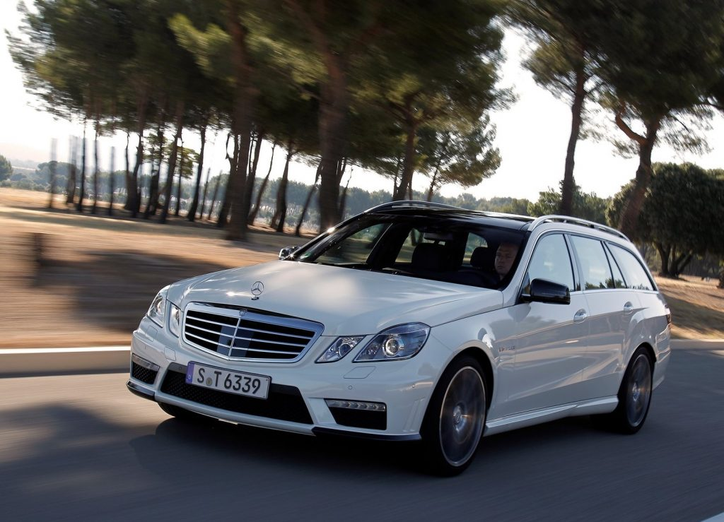 White 2012 Mercedes-Benz E63 AMG Wagon driving on a shadowy road
