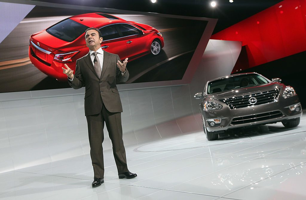 The 2013 Nissan Altima being introduced at an auto show