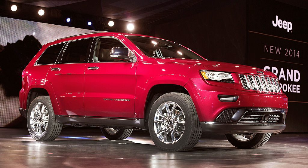 A 2014 Jeep Grand Cherokee at an auto show