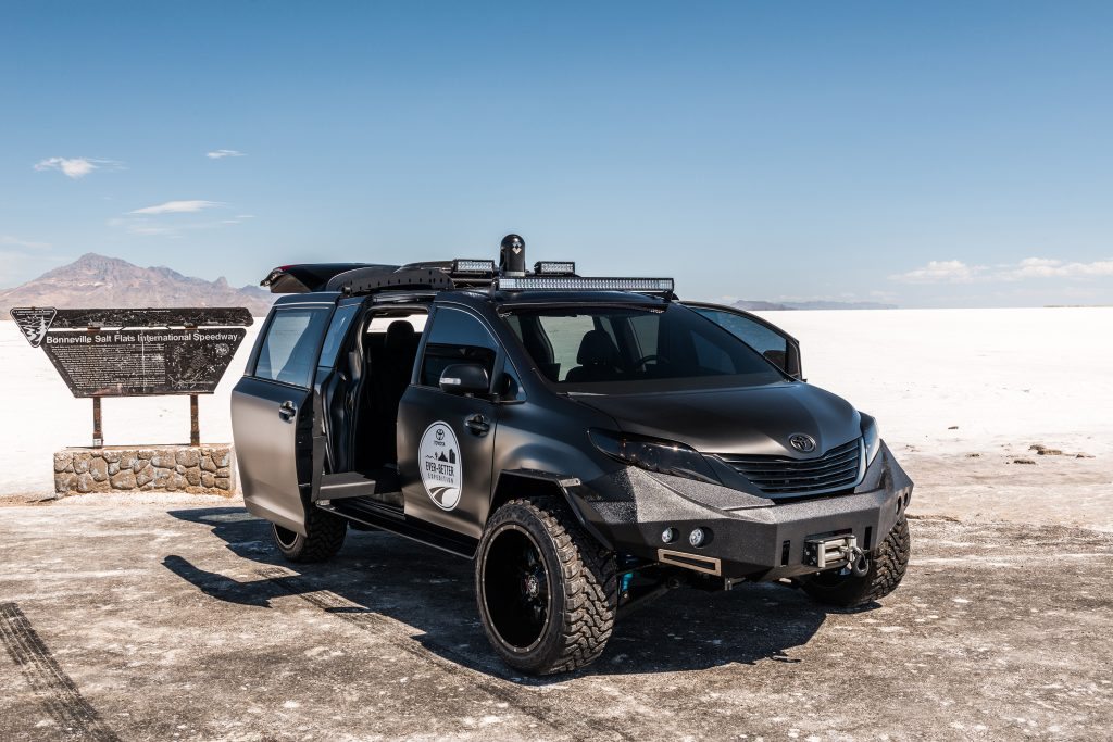 an all black overland minivan build that looks ready to take on anything