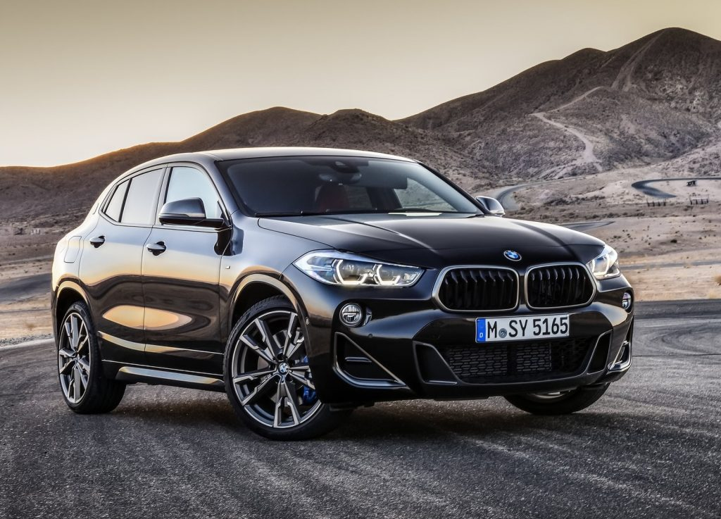 Black 2019 BMW X2 M35i parked on a desert racetrack