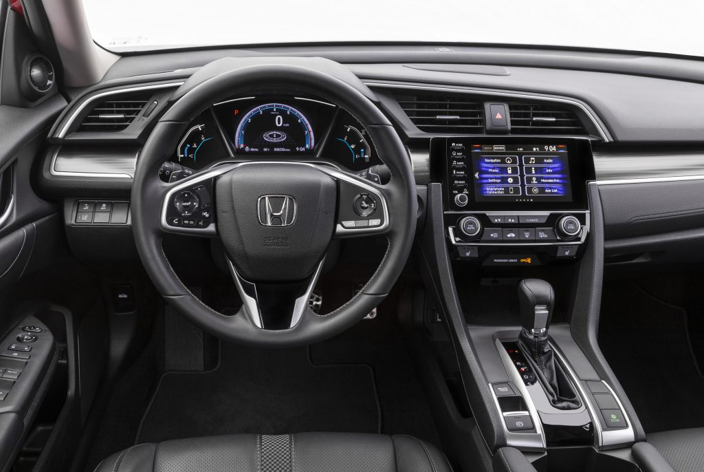 The front row of of the 2020 Honda Civic with leather-trimmed seats.