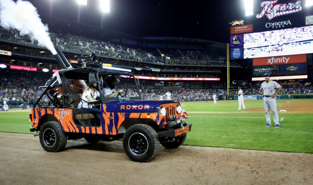 A 2019 Mahindra Roxor UTV being driven around in a stadium. Similarities to the Jeep Wrangler can't be denied.