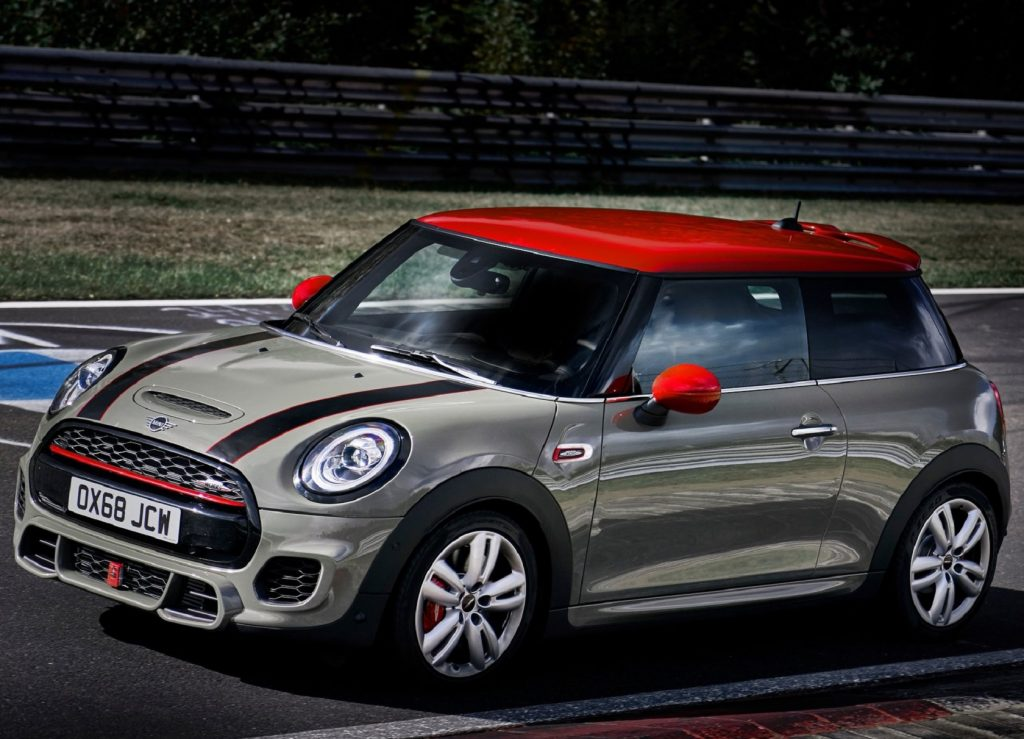 Tan 2019 Mini Cooper JCW hatchback going around a track