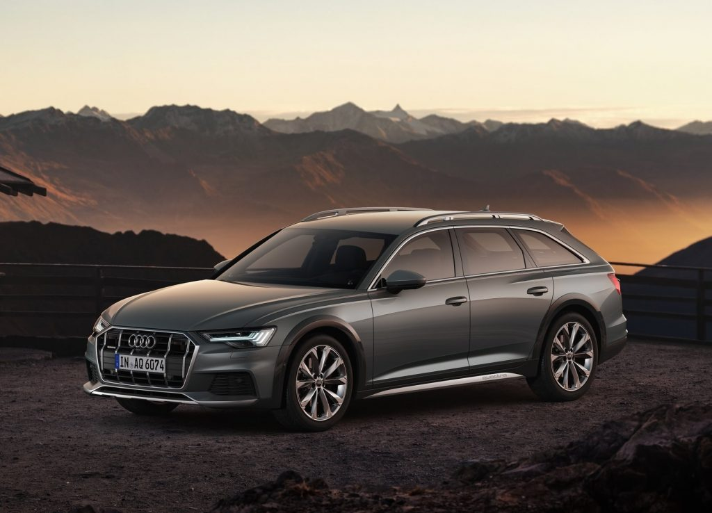 Gray 2020 Audi A6 Allroad in front of a mountain range at sunset