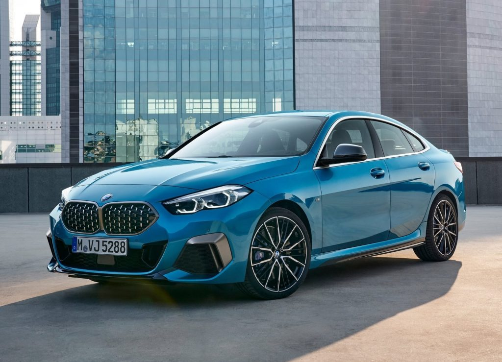 Blue 2020 BMW M235i Gran Coupe parked on top of a city parking garage