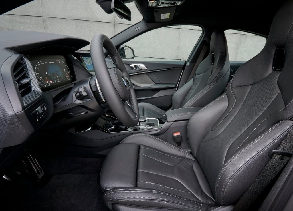 Front seats, driver gauges, and center console of the 2020 BMW M235i Gran Coupe, in black leather
