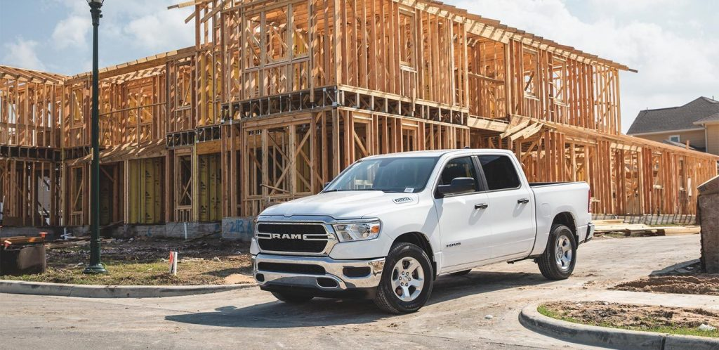 a white Ram work truck on the job