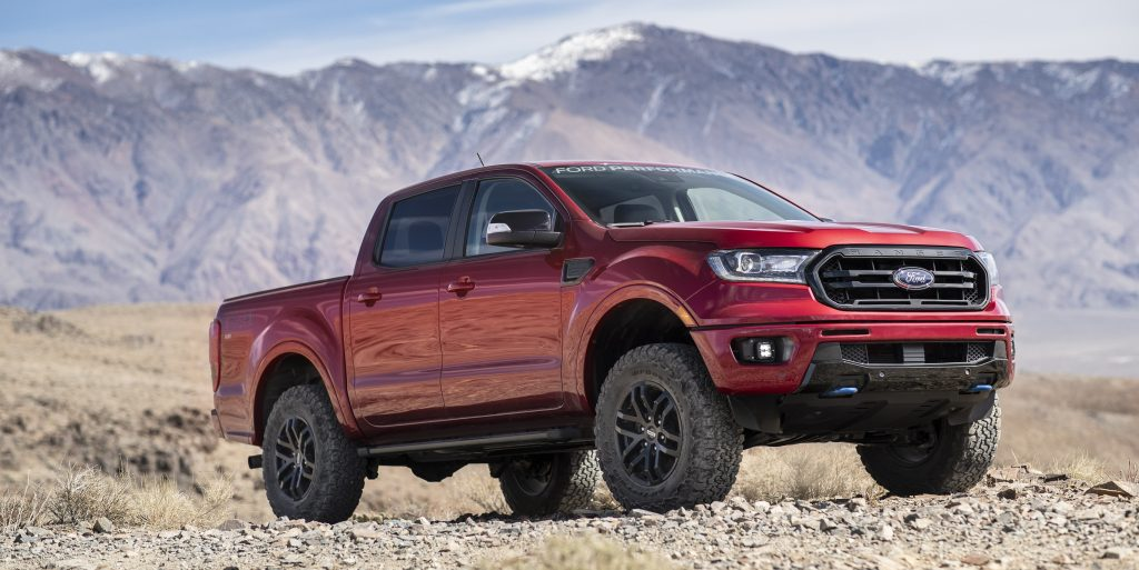 Red 2020 Ford Ranger pickup truck with Ford Performance Level 2 Package in the desert in front of a mountain range