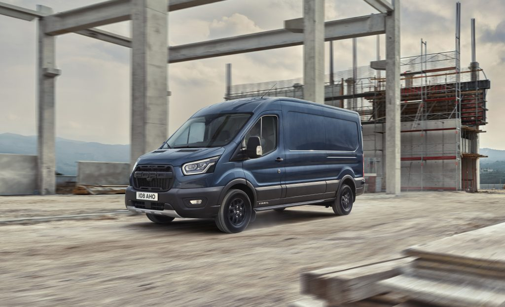 Blue 2020 Ford Transit Trail van driving through a construction site