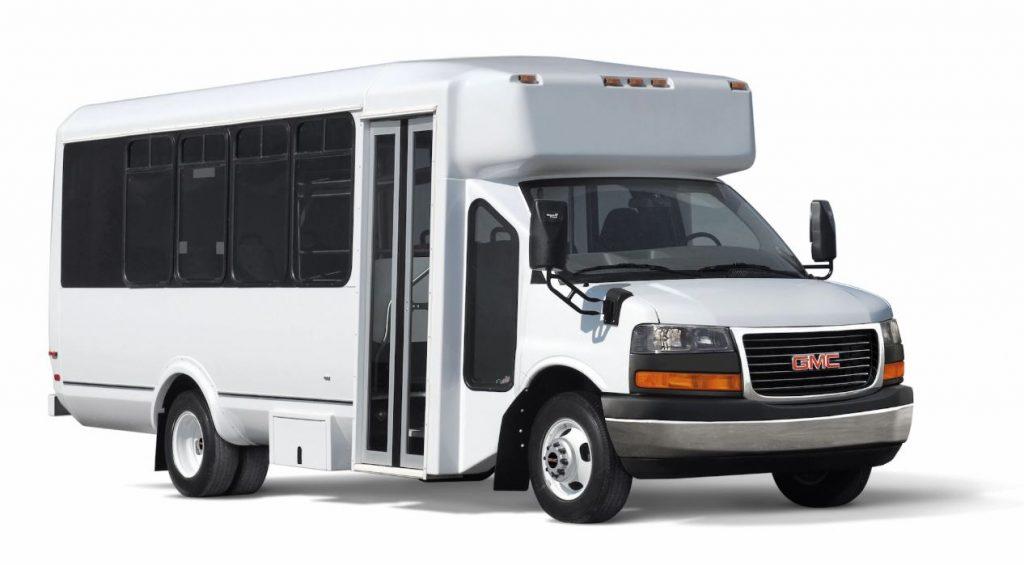 A new, white GMC shuttle van built on a GMC Savana